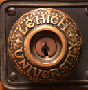 Photo of door knob with Lehigh University embossed on it